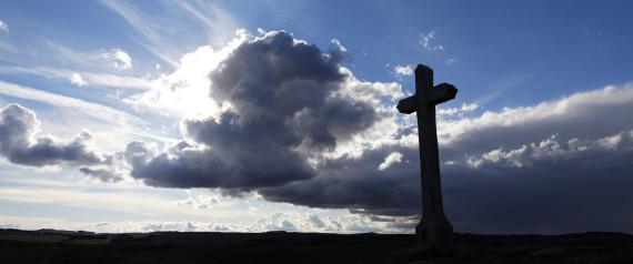 Memorial cross at sunset